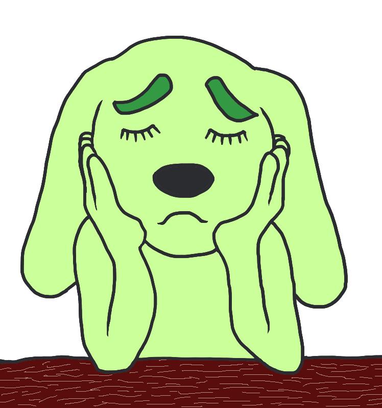 悩む緑色の犬
